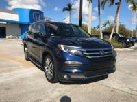 2017 Honda Pilot Touring in Blue. Extra roomy.