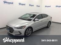 CARFAX 1-Owner. SYMPHONY SILVER exterior and GRAY