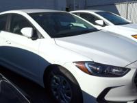 QUARTZ WHITE PEARL exterior and GRAY interior, SE trim.