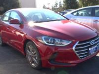SE trim, SCARLET RED exterior and BEIGE interior.
