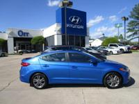 SE trim, Electric Blue Metallic exterior and Gray