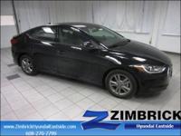 SE trim, Phantom Black exterior and Gray interior. EPA