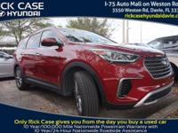 2017 Hyundai Santa Fe SE in Red. Cloth. Traction
