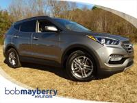 This 2017 Hyundai Santa Fe Sport 2.4L Mineral Gray with