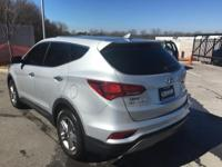 This outstanding example of a 2017 Hyundai Santa Fe