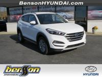 Tucson Eco, FWD, and White. The SUV that never quits!