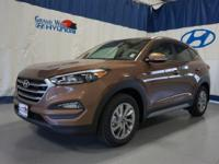 Tan 2017 Hyundai Tucson SE AWD 6-Speed Automatic with