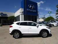 Dazzling White exterior and Beige interior, SE trim.