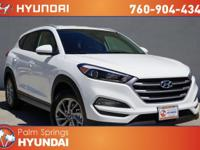 Tucson SE, 2.0L DOHC, and 6-Speed Automatic with
