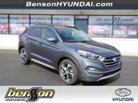 Tucson Value, 4D Sport Utility, FWD, Grey, and Black.