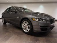 This 2017 Jaguar XE 25t Premium is offered in Ammonite