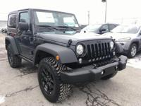 This 2017 Jeep Wrangler Sport in Rhino Clearcoat