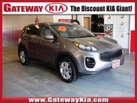 KIA CERTIFIED, THIS GRAY SPORTAGE LX HAS A CLEAN