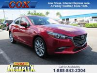 This 2017 Mazda Mazda3 Touring in Red is well equipped