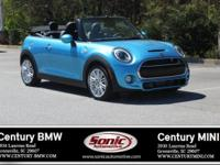 Scores 32 Highway MPG and 23 City MPG! This MINI