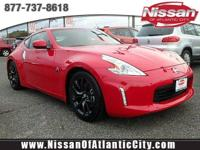 Come see this 2017 Nissan 370Z Touring. Its Manual