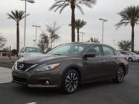 This 2017 Nissan Altima is complete with top-features