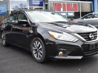 This 2017 Nissan Altima is a dream to drive. This