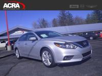 A few of this used Altima's key features include: a