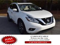 Delivers 28 Highway MPG and 21 City MPG! This Nissan