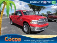 This 2017 Ram 1500 Laramie in Red features: Clean
