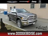 This Ram 2500 boasts a Premium Unleaded V-8 6.4 L/392