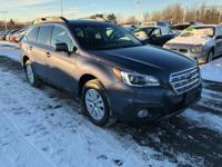 7,000 mile Subaru certified pre-owned AWD Outback
