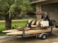 It is a 2017 Tahitian CraigCat with a 30 HP Evinrude