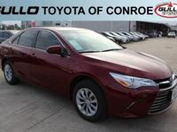 Red 2017 Toyota Camry LE 33/24 Highway/City MPGLet the