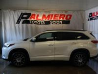 This 2017 Toyota Highlander SE in Blizzard Pearl