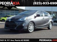 This is a low mileage 2017 Toyota Prius C model with a