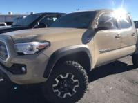 From mountains to mud, this certified Tan 2017 Toyota
