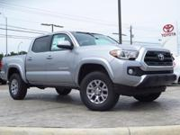 New Arrival! 4-Wheel Drive. This Tacoma  has many