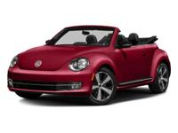 The Volkswagen Beetle has a sleek rounded profile, and