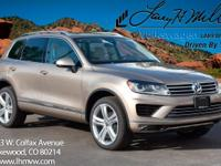 This Sand Gold 2017 Touareg V6 Executive comes with