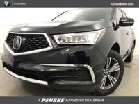 MDX trim, Crystal Black Pearl exterior and Parchment