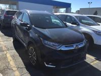 This outstanding example of a 2017 Honda CR-V Touring