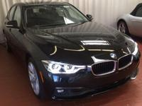 Jet Black 2018 BMW 3 Series 320i xDrive AWD 8-Speed