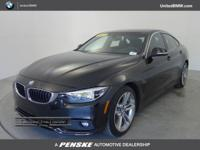 CARFAX 1-Owner. Black Sapphire Metallic exterior and