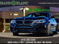 Black Sapphire Metallic 2018 BMW M5 AWD V8 8-Speed