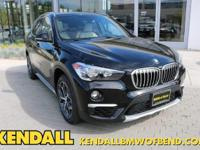 This outstanding example of a 2018 BMW X1 xDrive28i is