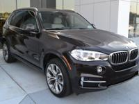 This 2018 BMW X5 is Sparkling Brown Metallic with Ivory