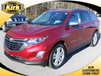 Check out this 2018 Equinox Premiere. This was a new