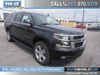 This four wheel drive Suburban features leather front