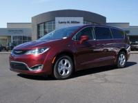This Chrysler Pacifica boasts a Gas/Electric V-6 3.6