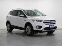 This outstanding example of a 2018 Ford Escape Titanium