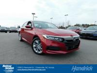 LX trim, Radiant Red Metallic exterior and Ivory