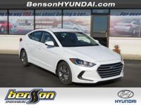Elantra SEL, White Pearl, and Beige. Optimizes every