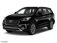 Treat yourself to this 2018 Hyundai Santa Fe SE, which