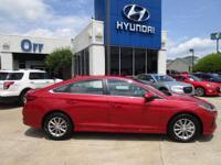 Scarlet Red exterior and Gray interior, SE trim. FUEL